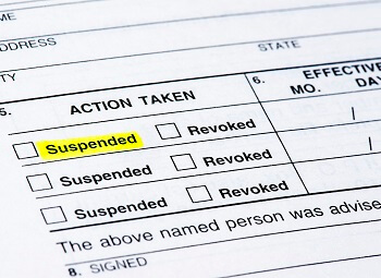 Form with an action taken section with checkboxes for suspended and revoked with the first suspended highlighted